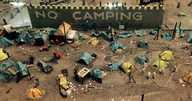 adp-camping-outside-city-walls-by-jimmy-cauty