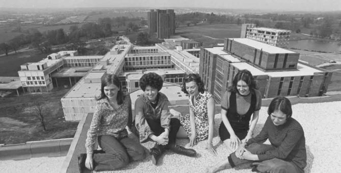 Students sitting on towers at Colchester Campus